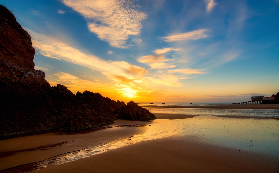 A sandy beach in Pembrokeshire at sunset