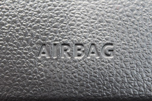 An airbag sign on a steering wheel