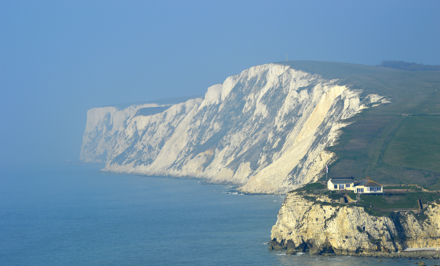 A view of white cliffs stretching into the distance on the Isle of Wight