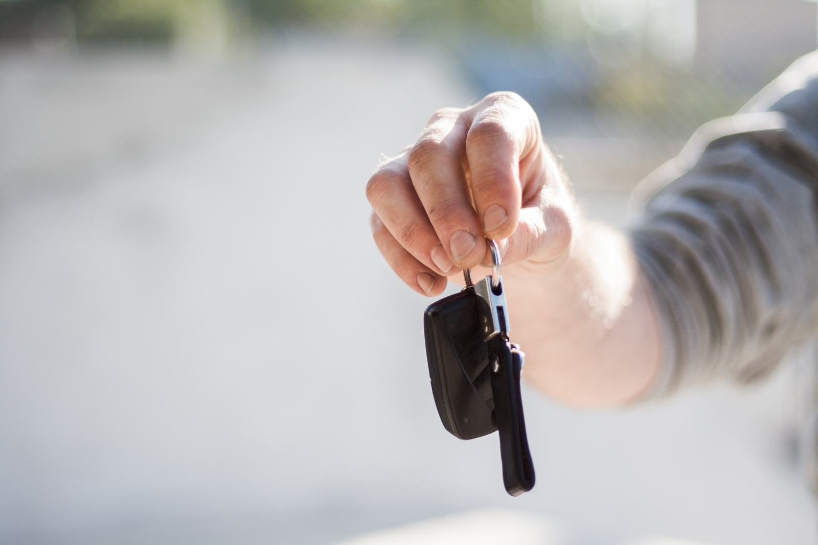 A person holding up a motorhome key