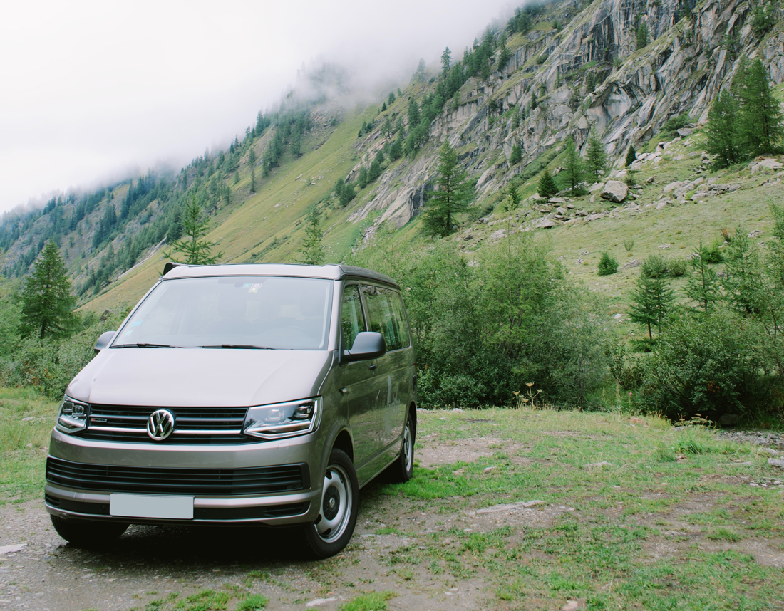 A campervan parked in an alpine region