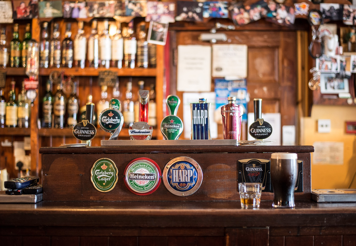 Various beers on tap at the bar of a traditional pub