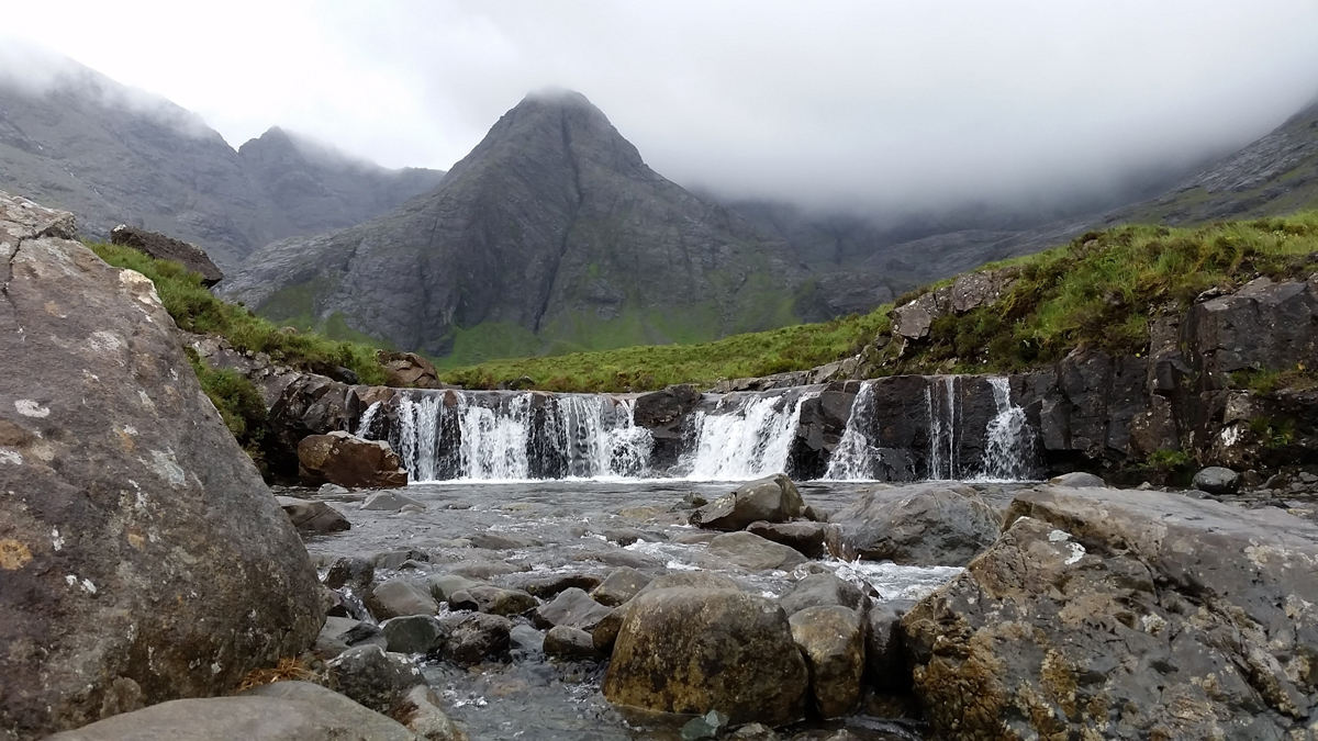 The Fairy Pools at the bottom of a mountainous area on the Isle of Skye in Scotland