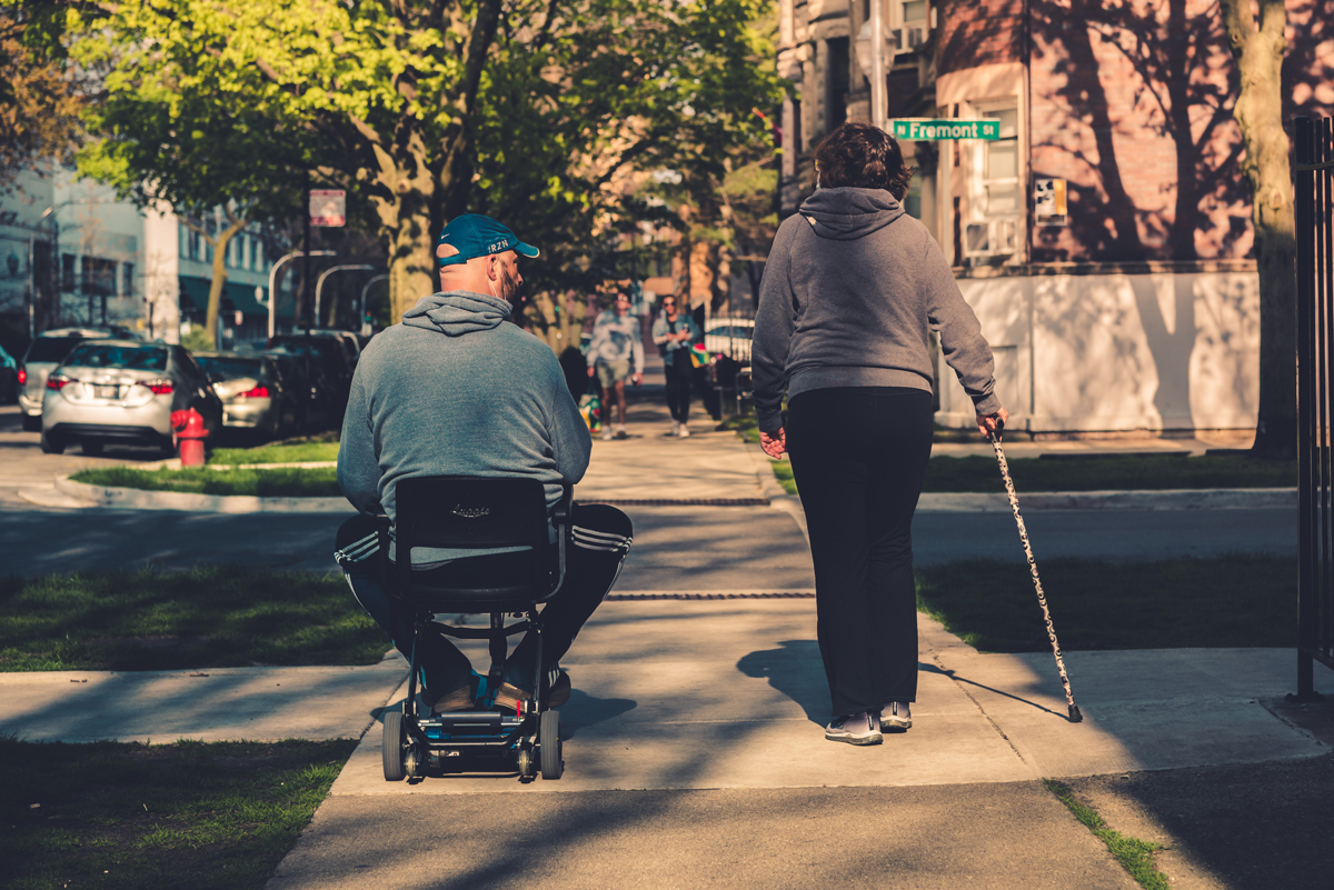 A disabled couple walking along a pathway