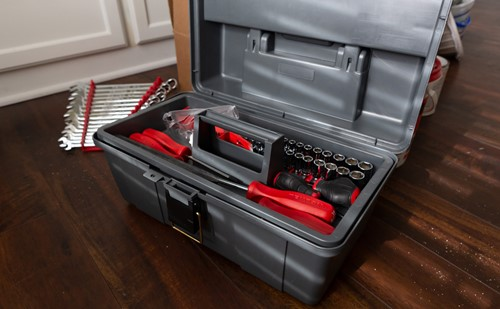 An organised tool box with screwdrivers, sockets and spanners