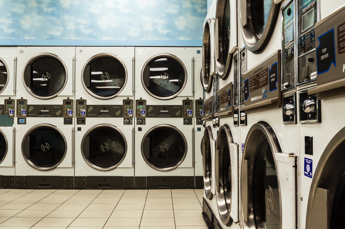 A launderette with many washing machines
