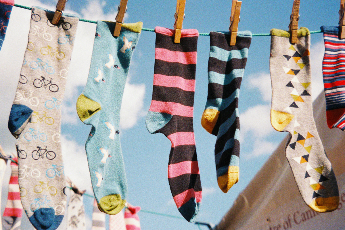 A clothes line with socks hanging up to dry
